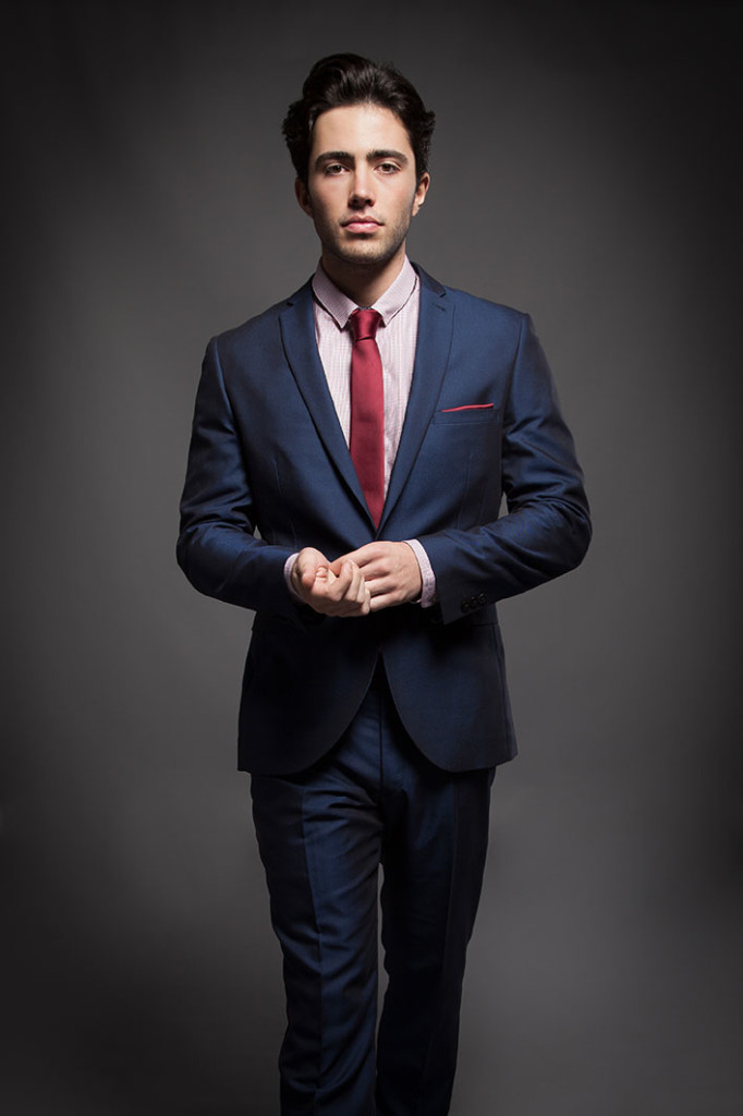 Navy blue suit, light red shirt and red tie color combination