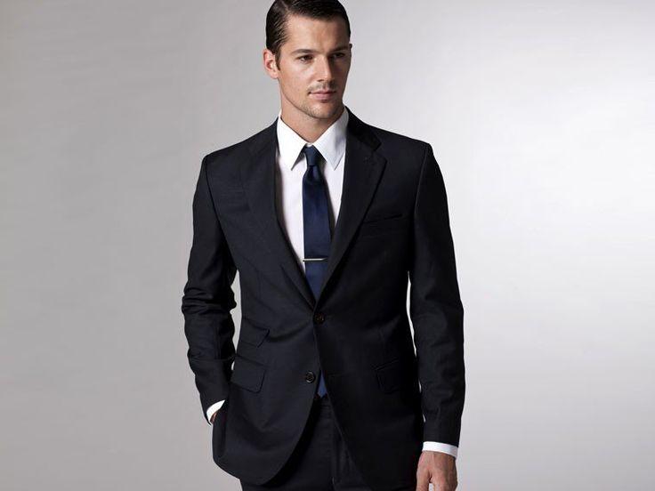 Black suit, white shirt and blue tie color combination