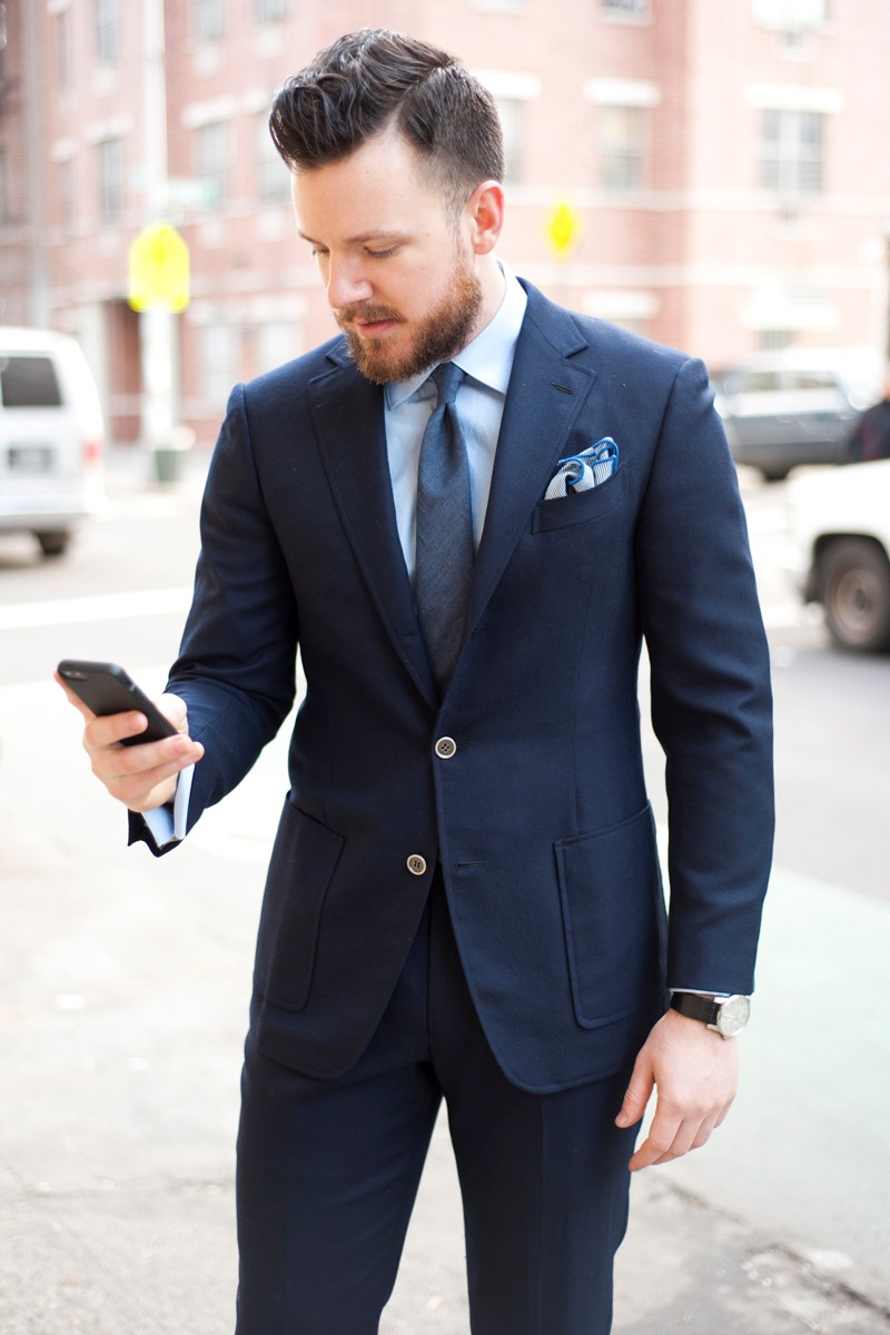 Navy blue suit, light blue shirt, blue tie mixed with brown shoes