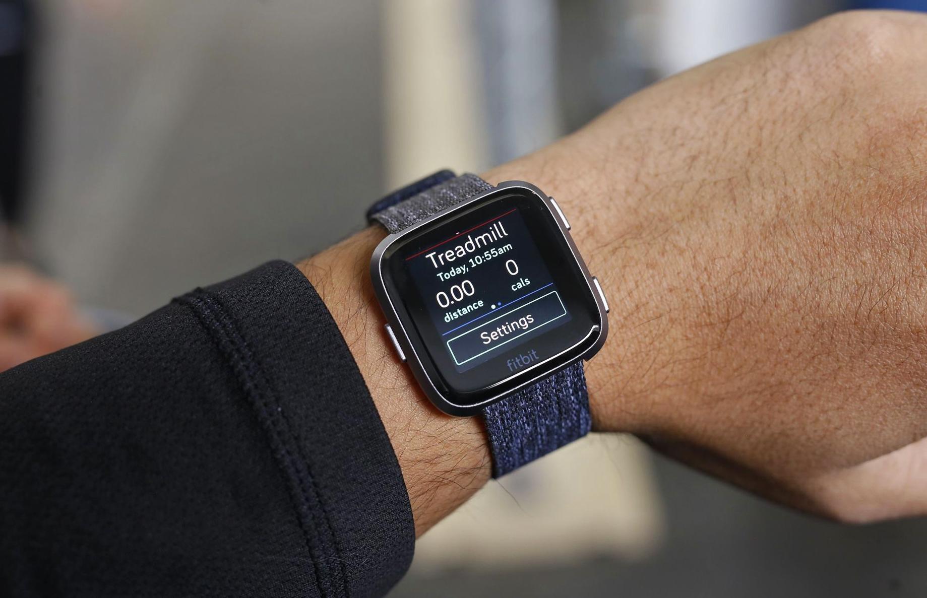 Fitbit Versa on man's hand