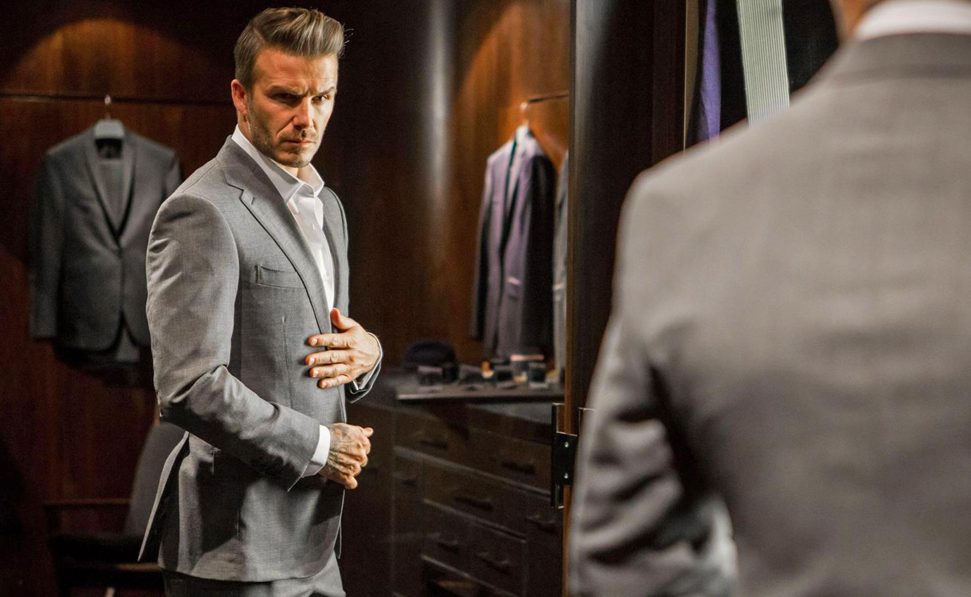 David Beckham wearing a light-grey suit