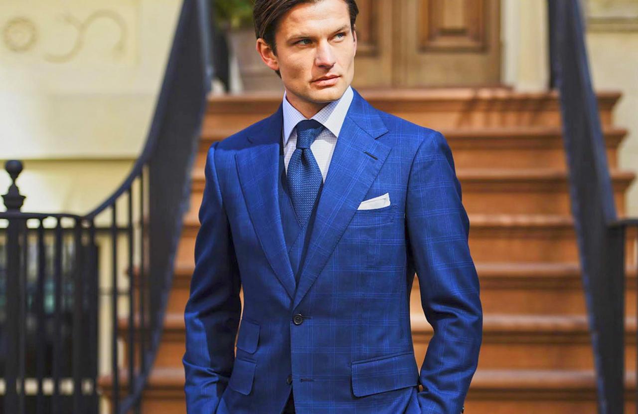 One-color scheme: Navy suit, soft blue shirt and a blue tie