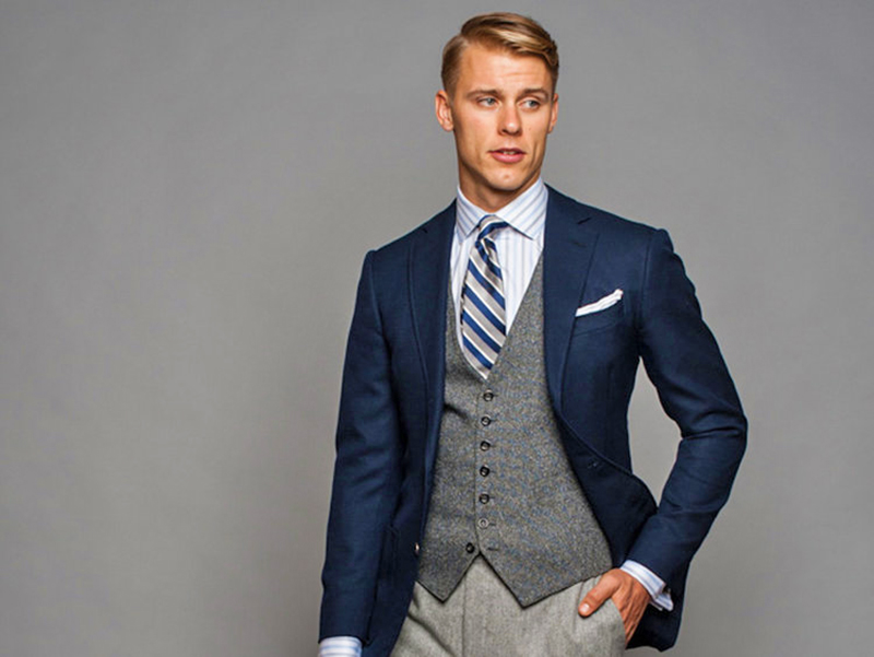 wearing contrasting vest and suit jacket