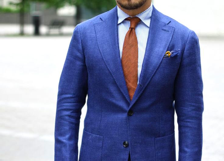 Complimentary colors scheme: Navy suit dark orange tie color combination