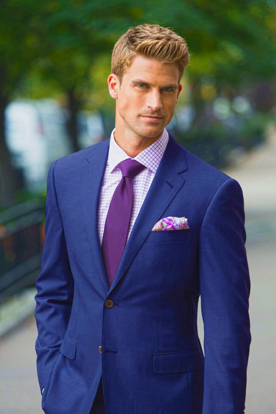 Blue suit with a purple shirt and slightly darker purple tie