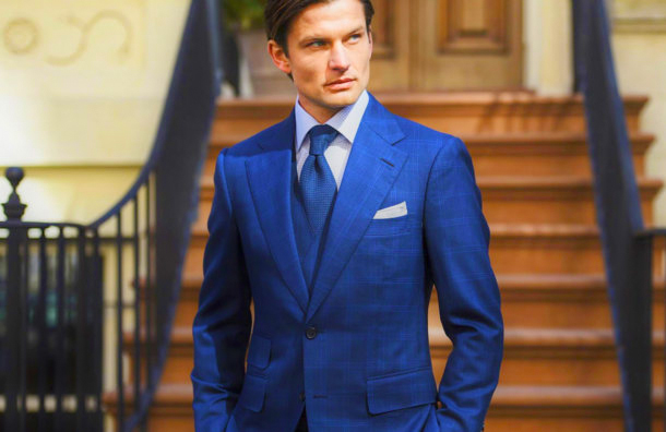 Elegant blue siot with a blue tie displays confidence