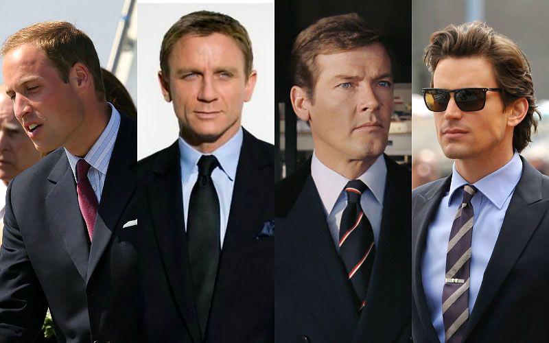 Black suit & pale blue shirt with a tie