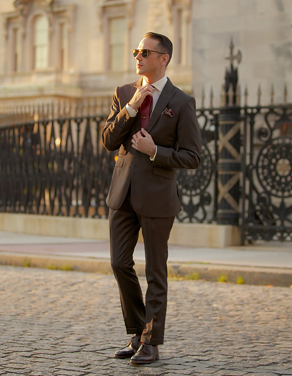 Brown suit with white shirt, burgundy tie and burgundy shoes