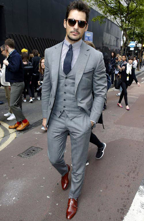 Light grey suit with blue stripe shirt, navy tie and brown shoes color combination