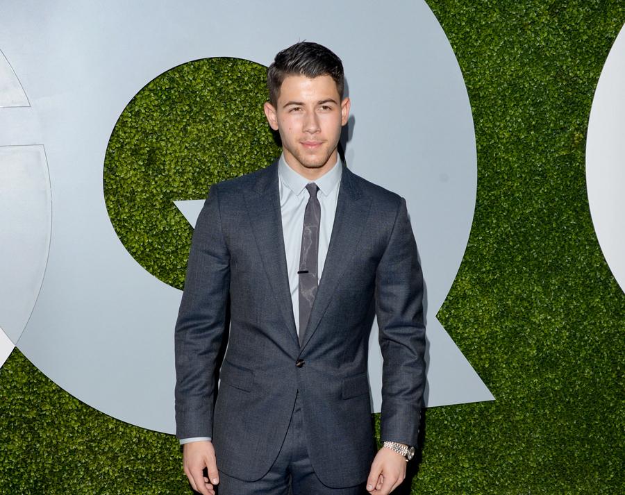 Nick Jonas wears a Calvin Klein suit