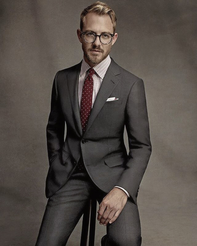 Charcoal suit, striped pink shirt and burgundy tie