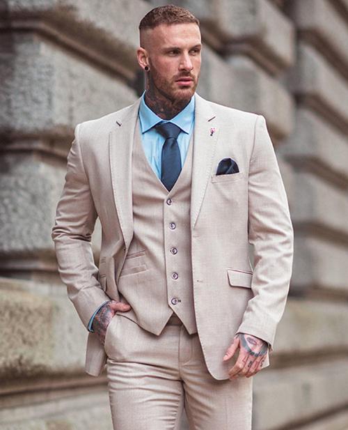 beige suit with a pale blue shirt