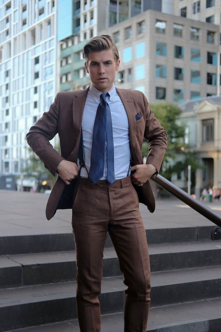 navy blue tie and light blue shirt with brown suit