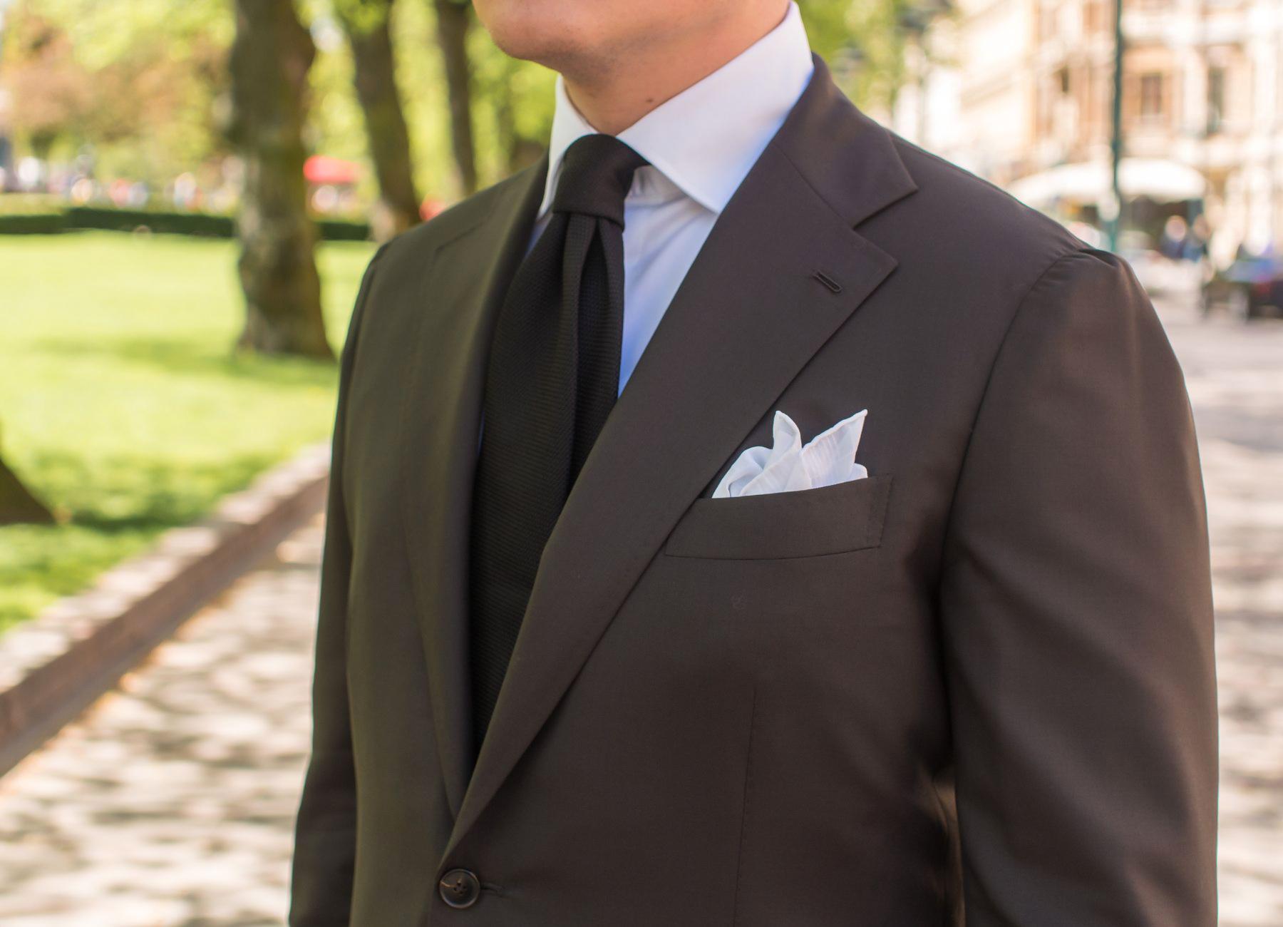 brown suit, white dress shirt and black tie color combination