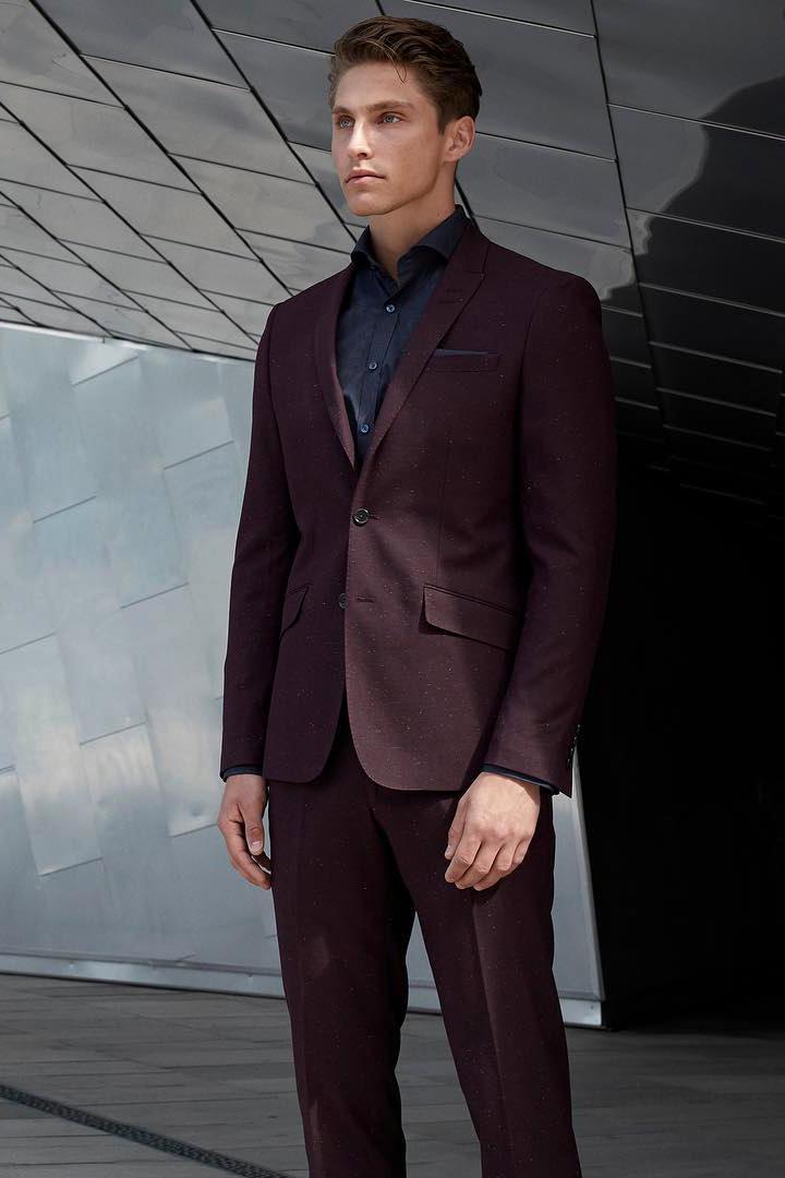 Burgundy suit & black shirt color combination