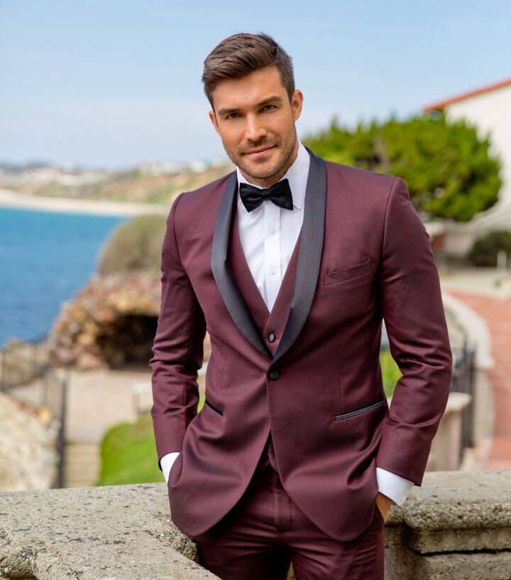 Burgundy tuxedo worn as a wedding attire
