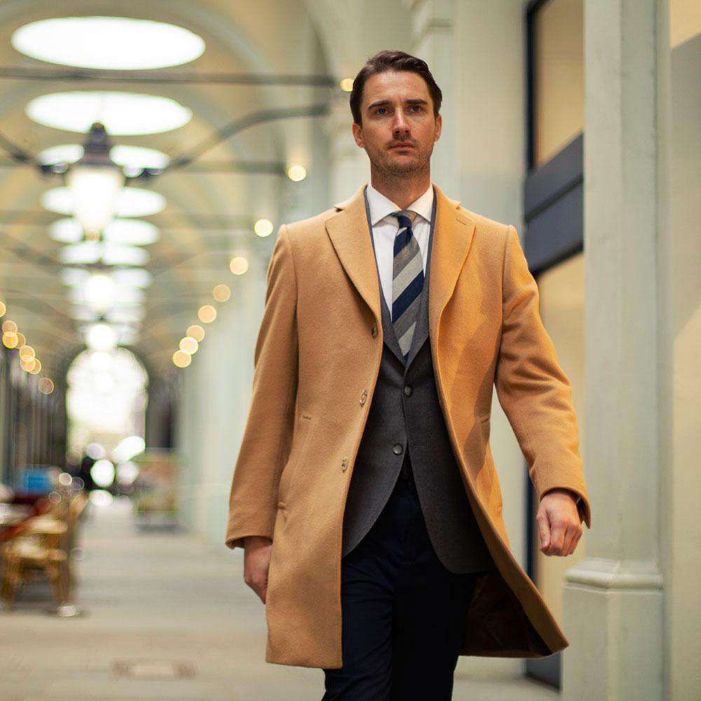 Camel coat over charcoal grey suit