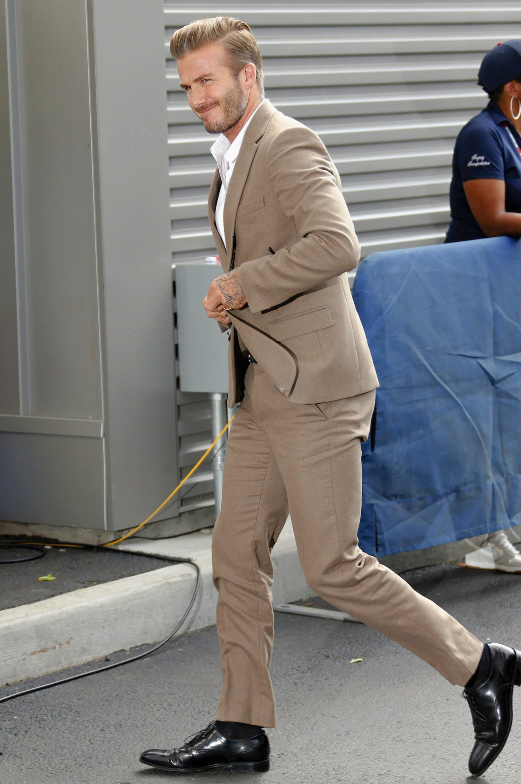 David Beckham in a tan suit and a white dress shirt