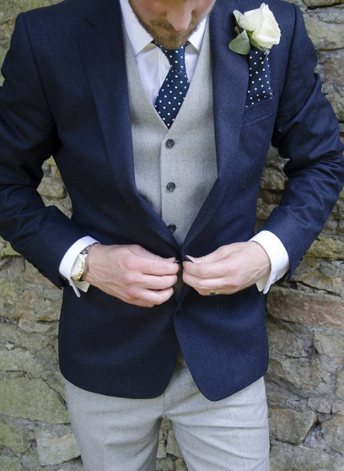 Grey vest with navy blue jacket and grey pants