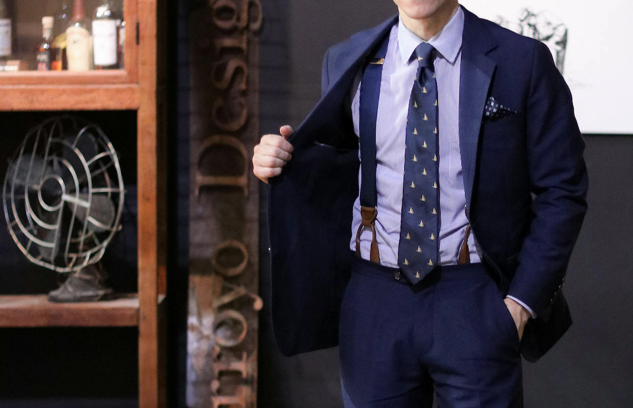 navy suspenders match perfectly with navy suit