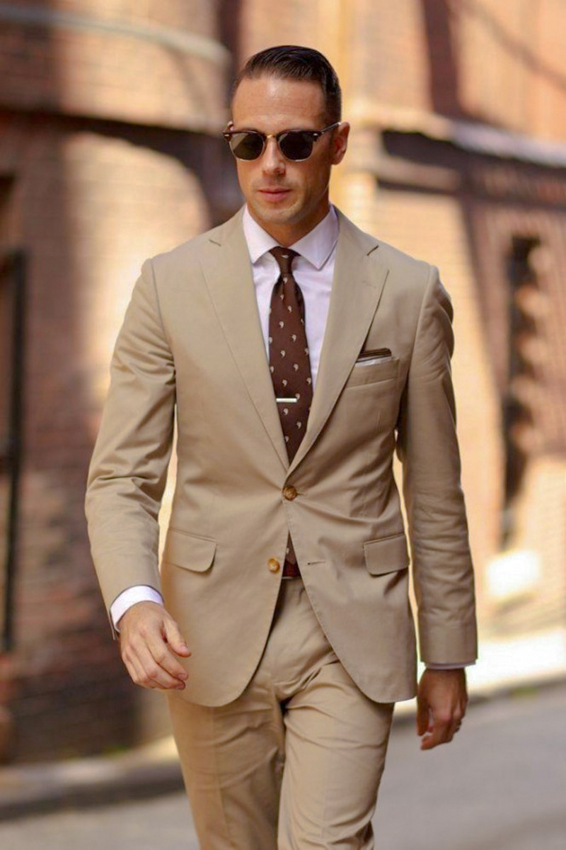 Tan suit, pale pink shirt and brown tie