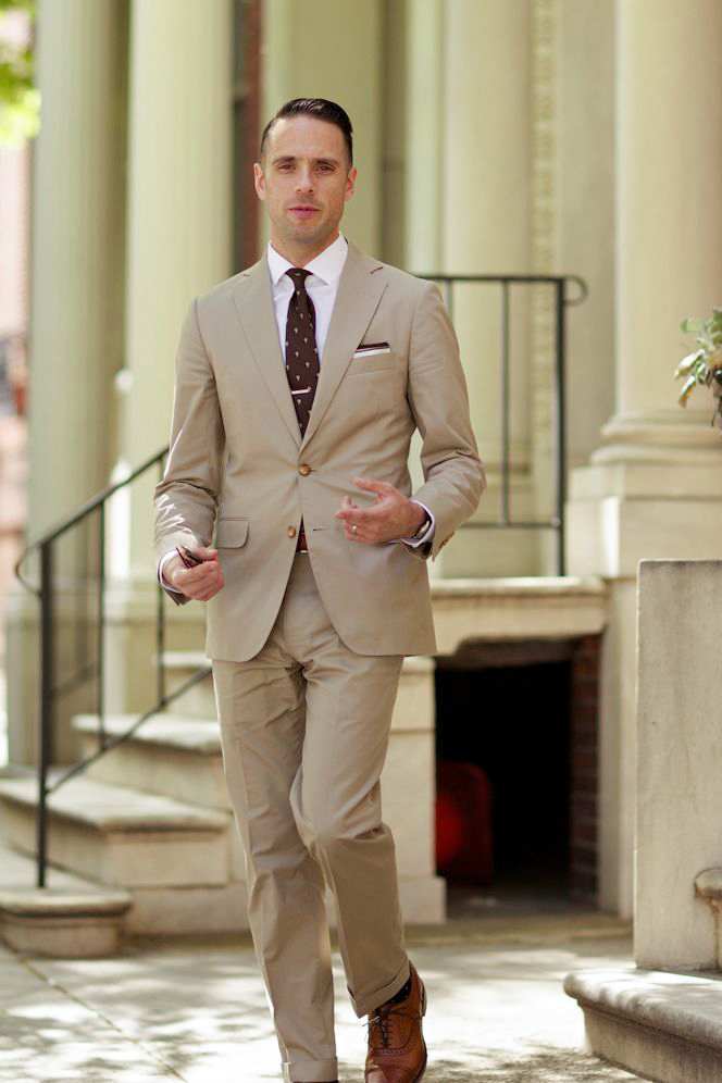 Tan suit, white shirt, and brown tie color combination