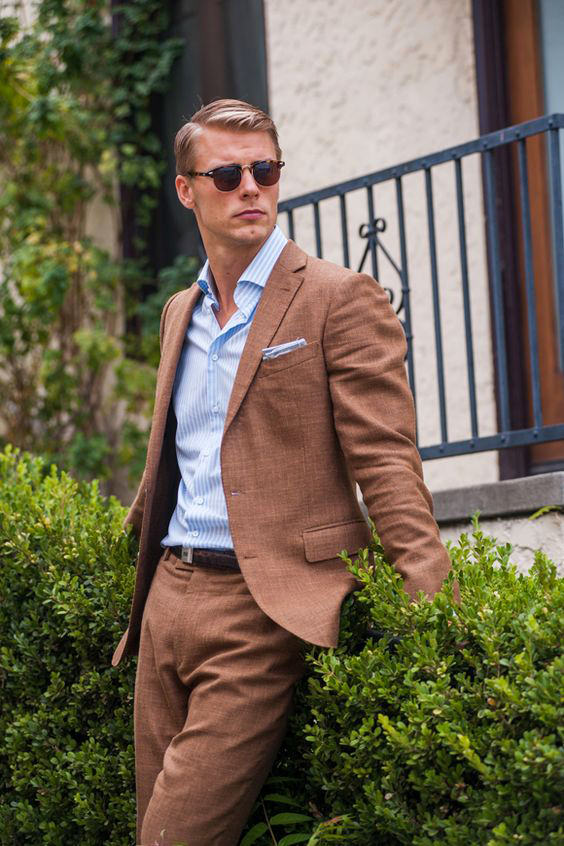 textured brown suit with pale blue striped shirt
