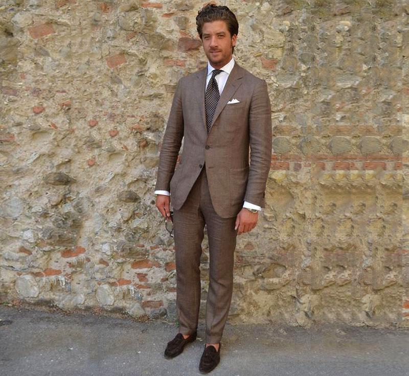 wearing brown linen suit
