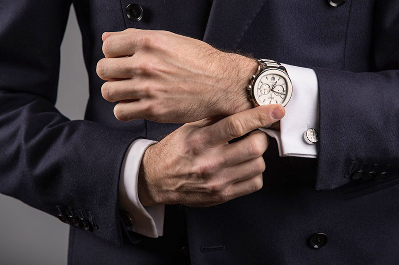 Wearing a chronograph watch with a suit